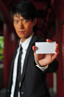 Asian Man Holding Card Stock Photos