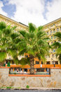 Free Big Palm Tree In Front Of A Hotel Stock Photo - 9412410