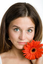 Free Beautiful Woman With A Bright Red Flower Royalty Free Stock Photography - 9413357