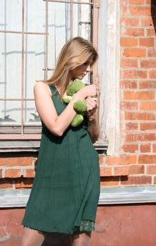 Girl With A Toy Frog Stock Photo