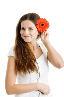 Beautiful Woman With A Bright Red Flower Royalty Free Stock Image