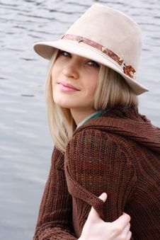 Free Blonde In Hat Sits On Coast Lake Stock Photo - 9415280