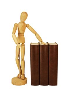 Wooden Dummy And Pile Of Old Books Stock Image