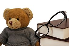 Teddy Bear, Glasses And A Pile Of Old Books Stock Photo