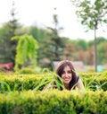 Free Young Girl Hiding Over Bush Stock Photos - 9421743