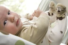 Free Baby Boy Lying On Back With Feet Up In The Air Royalty Free Stock Photos - 9425208