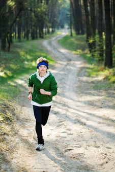 Free Girl Runner In The Forest Royalty Free Stock Image - 9426146