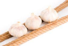 Free Three Bulbs Of Garlic Near The Rope Royalty Free Stock Photos - 9426328