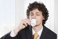 Free Businessman Taking A Break With A Cup Of Coffee Royalty Free Stock Image - 9427136