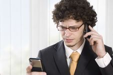 Free Troubled Business Man With Two Mobile Phone Royalty Free Stock Photos - 9427138