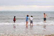 Free Father And Children Wading In Cold Sea Stock Photo - 9428710
