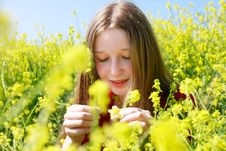 Free Girl With Long Hair In Yellow Flowers Royalty Free Stock Photo - 9429825