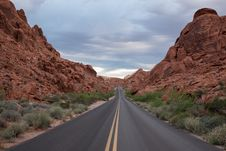 Free Empty Road Through Sandstone Rocks Stock Photography - 94244002