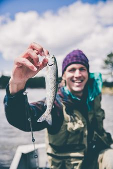 Free Man With Small Fish Royalty Free Stock Photos - 94244458