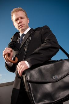 Free Businessman Holding Briefcase Stock Photo - 9430590