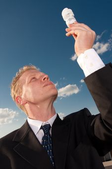 Free Businessman Holding Lightbulb Royalty Free Stock Photos - 9430768