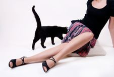 Free Female Legs And A Black Cat Stock Photo - 9434010