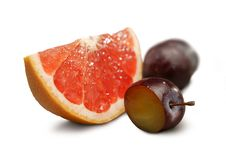 Free Grapefruit And Plums Royalty Free Stock Images - 9434229
