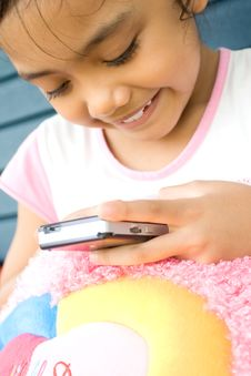 Free Little Girl With Cellphone Royalty Free Stock Image - 9435116