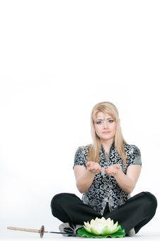 Woman Meditating In Lotus Pose Royalty Free Stock Photos