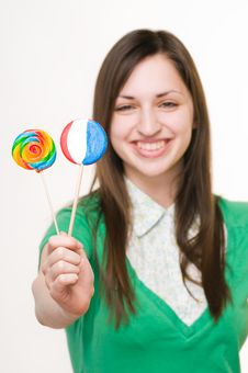 Free Young Smiling Girl With Lollipops Royalty Free Stock Photography - 9436637