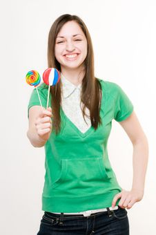 Free Smiling Girl With Lollipops Royalty Free Stock Photo - 9436645