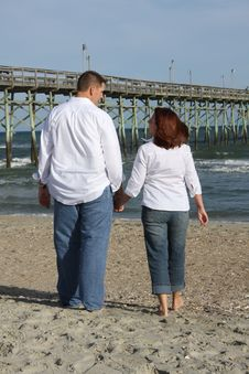 Free Couple Walking On The Beach Too Stock Photos - 9438863