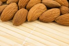 Free Group Of Almonds On A Bamboo Mat. Royalty Free Stock Photography - 9438977