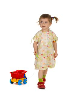 Free Little Girl Carries The Toy Car Royalty Free Stock Photography - 9439307