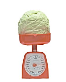 Free Kitchen Scale Weighting Cabbage Royalty Free Stock Images - 9439629