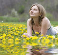 Free Blonde Girl Laying In A Meadow Royalty Free Stock Images - 9448369