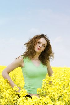 Free Happy Young Woman Relaxing In Rape Flower Field Royalty Free Stock Photos - 9442178