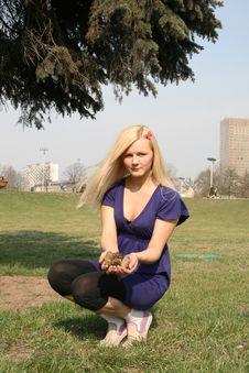 Girl Sitting Under Fir Tree Stock Photo