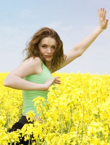 Free Attractive Girl Doing Yoga In Rape Flower Field Stock Photography - 9442232