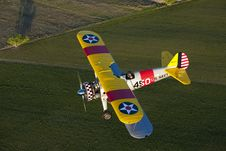 Free Yellow Biplane Over Field Stock Image - 9447151