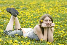 Free Blonde Girl Laying In A Meadow Stock Photography - 9448402