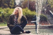 Free Blond Girl Sitting Beside Fountain Stock Image - 94484481