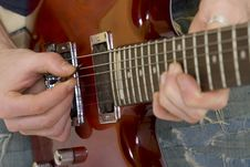 Closeup Of The Strings Of An Electric Guitar Royalty Free Stock Images