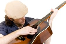 Free Seated Guitarist Playing An Acoustic Guitar Stock Photography - 9450512