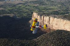 Free Yellow Biplane Over Large Canyon Stock Photo - 9452650
