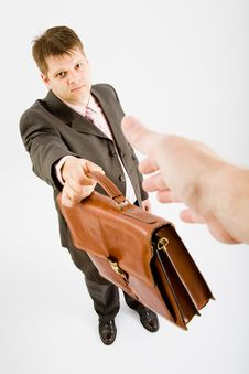 Free Business Man Give A Bag Royalty Free Stock Photo - 9455385