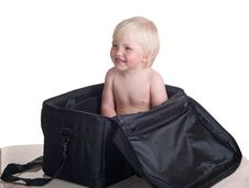 Smiling Child Into Bag Stock Images