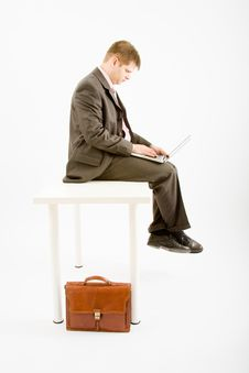 Free Young Business Man With Laptop Stock Image - 9456341