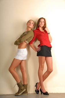 Two Pretty Girls In Sport And Classic Styles Stock Photo