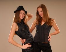 Free Attractive Twin Girls In Black Clothes Stock Image - 9457141
