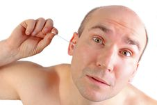 Free Man With Funny Look Using A Q-tip Royalty Free Stock Images - 9458519