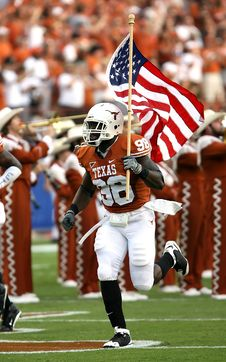 Free Nfl Player Holding U.s.a. Flag On Field Royalty Free Stock Photography - 94580967