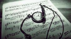 Free Pocket Watch On Sheet Music Stock Photography - 94581032
