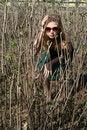 Free Girl Sitting Among Bushes Stock Photography - 9461882