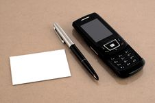 Free Mobile Phone With Pen And Blank Business Card Stock Images - 9460134